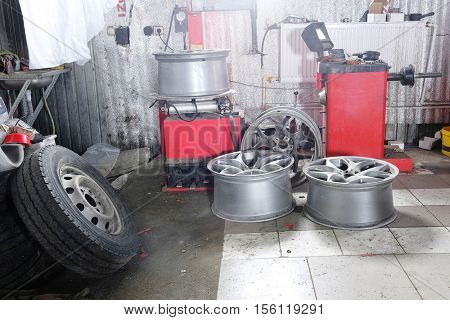 Car wheels in a tyre fitting workshop