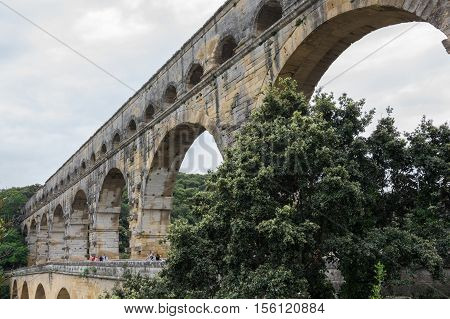 NIMES FRANCE - MAY 04 2015: Pont du Gard over the Gardon river is roman aqueduct built to provide water to the city of Nimes from the river Eure in the first century A.D.