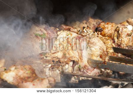 photographed closeup kebab made in nature. Used large pork meat
