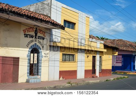 Leon Nicaragua - June 15 2015: Simple and colorful colonial buildings in the historic center of Leon Nicaragua
