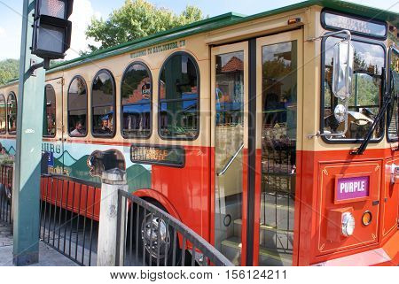 Gatlinburg Tennessee USA - October 1 2014: Fun time trolley is a famous tourist public transportation in Gatlinburg connecting some of the places in this area of Smoky Mountains Tennessee USA