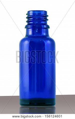 This is a blue medical bottle made of glass.