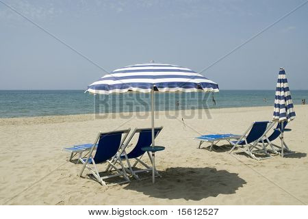 Empty chairs on the beach ready for you
