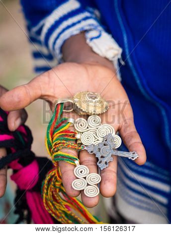 Crosses and other symbols sold as souvenirs by local children close to Axum Ethiopia.