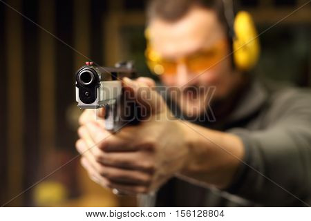 Sport shooting range. Science use of firearms. Shooting a gun at shooting range