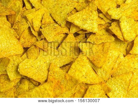 Detail of nachos or tortillas chips background.
