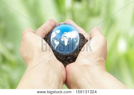 woman hands holding the earth on blurred green background. protection planet mother earth concept:reduce carbon dioxide emission:pure air