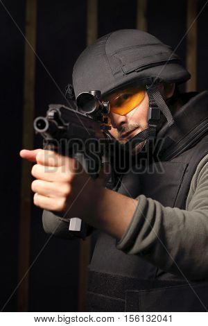 Antiterrorist. Man with a gun wearing a bulletproof vest and helmet