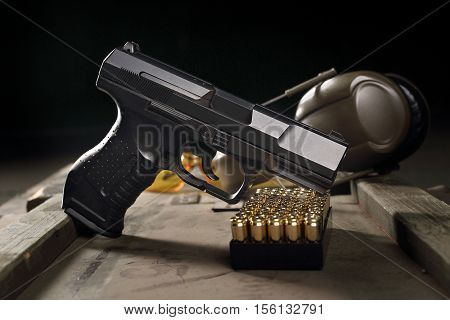 Glock pistol, cartridges and headphones protect ears
