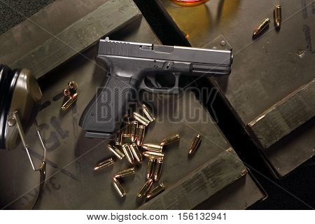 Glock pistol, cartridges and headphones protect ears