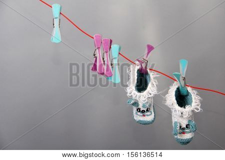 Childhood / Various children's clothing hanging on clothesline