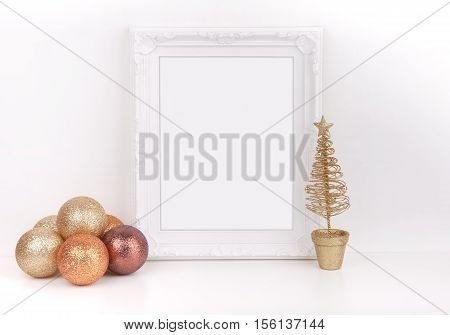 Christmas mockup styled stock photography with white ornate frame and gold glitter baubles with a gold christmas tree add quote promotion headline or design lifestyle bloggers and social media campaigns