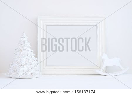 Christmas styled mockup landscape frame christmas tree and rocking horse overlay your business message promotion headline or design great for lifestyle bloggers and social media campaigns