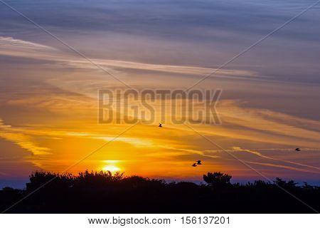 September sunrise and clouds over Seaford in Sussex.