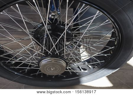 Vintage 1920's automobile wheel and metal spokes