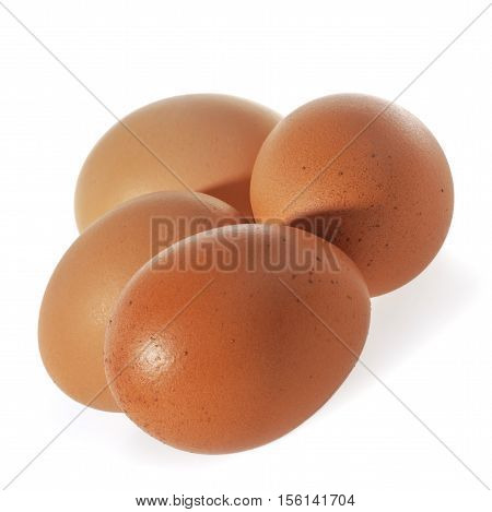 Three brown Eggs isolated on white background.