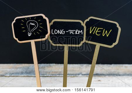 Concept Message Long-term View And Light Bulb As Symbol For Idea