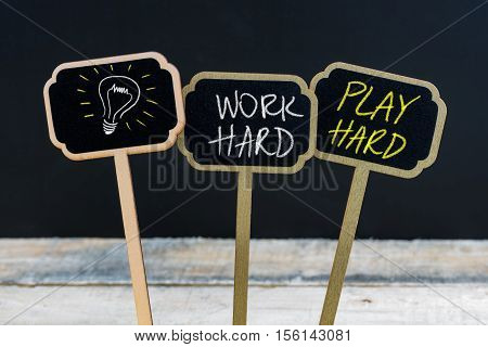 Concept Message Work Hard Play Hard And Light Bulb As Symbol For Idea