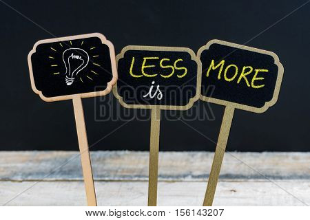 Concept Message Less Is More And Light Bulb As Symbol For Idea