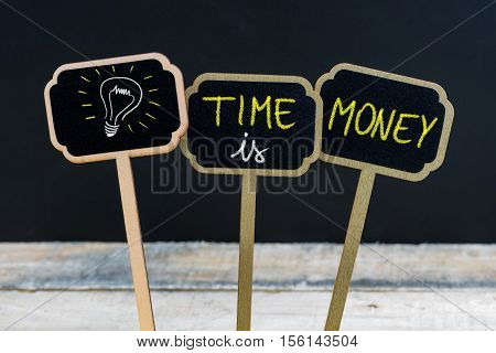Concept Message Time Is Money And Light Bulb As Symbol For Idea