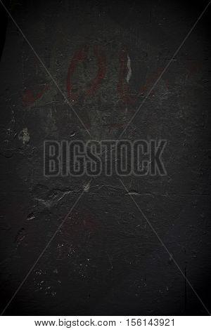 Rough textured black grunge concrete photo background