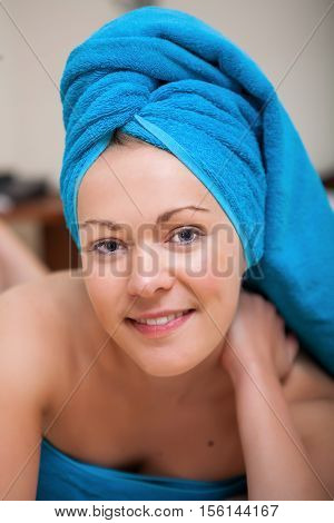 Pretty Young Woman With Blue Towel On Her Head