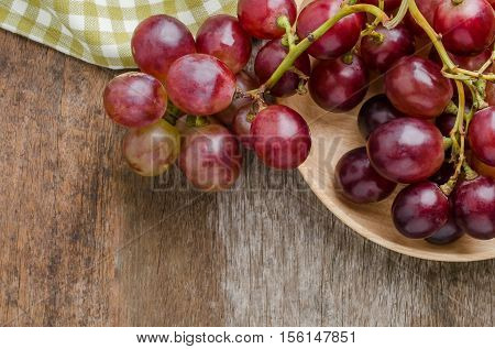 Fresh grape on old wooden table background