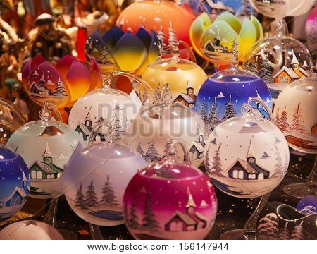 STRASSBOURG - DECEMBER 23: Colorful candlelights on the Christmas market in Strasbourg on December 23, 2013 in Strasbourg, France. Christmas market is famous tourist attraction of the city.