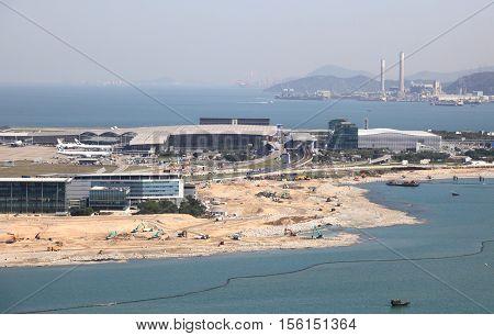 HONG KONG - APRIL 14, 2015: Hong Kong International Airport on April 14, 2015 in Hong Kong, China . The airport bay is undergoing land reclamation to build the Zhuhai-Macau-Hong Kong bridge.