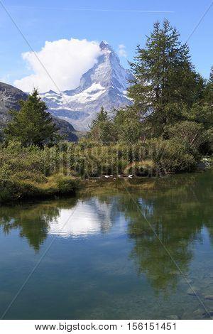 orest and lake at Matterhorn mountain, Switzerland