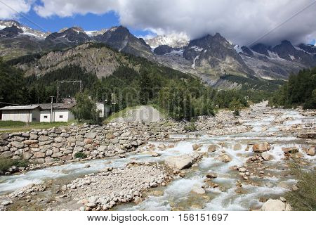 mountain landscape and waterfall at the foot of Mont Blanc