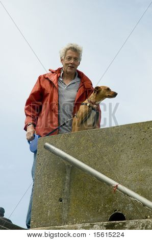 elderly man with his dog outdoor poster