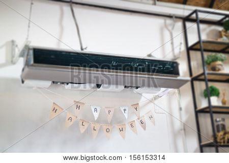 Hanging air conditioner and Halloween flags stock photo
