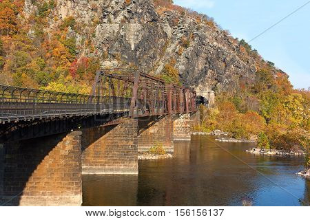 Bridge on the Appalachian Trail where the Potomac River meets the Shenandoah River. Autumn landscape in Harpers Ferry West Virginia USA.