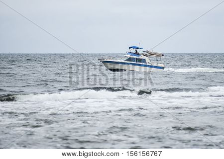 Trawler fishing boat sailing in open waters in the summer