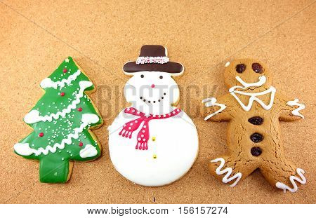 Christmas cookies; snow man Christmas tree and ginger bread man on wodden background
