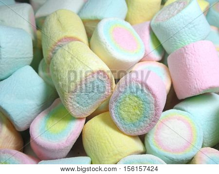 Pile of Pastel Yellow, Pink, Blue Colored Puffy Marshmallows
