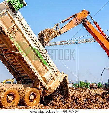 Excavators and earthmoving vehicles on the construction site.