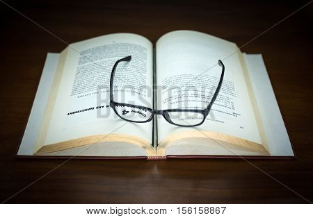 old book open and eyeglasses put on chapter 4