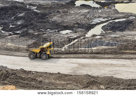 the big truck hauling material activity on open pit