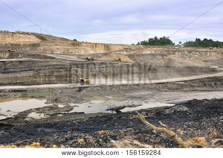 some big truck hauling material on open pit