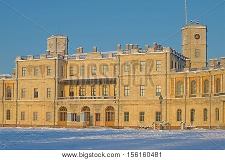 The central part of the old Big Gatchina palace in beams setting the sun in the January evening. Gatchina, Russia