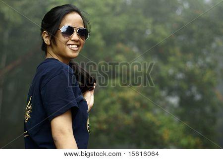 Happy asian malay teen lady outdoors