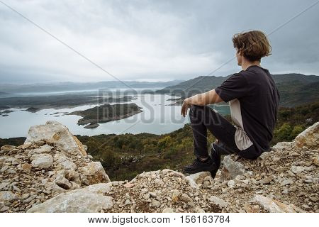 Attractive Traveler Looks At The Beautiful View