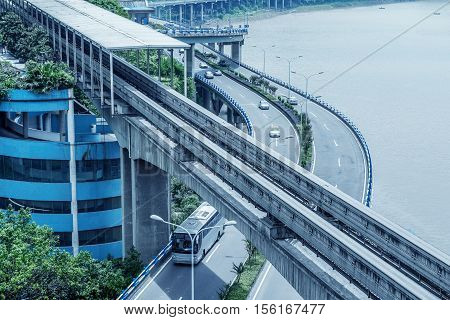 China Chongqing elevated light rail modern city traffic perspective.