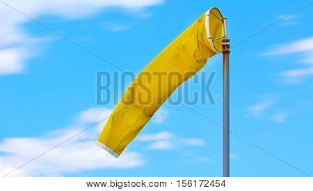 A yellow windsock used at airports to indicate the direction and strength of the wind to pilots.