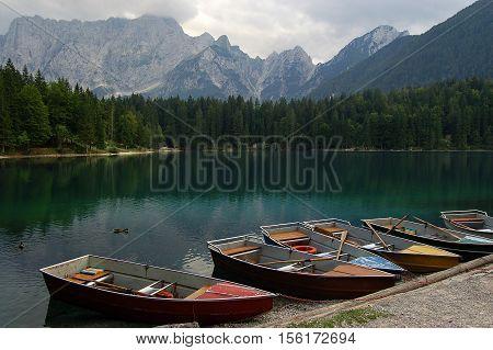 Rowboats in the Fusine Lake (Lago di Fusine). Small mountain lake in Julian Alps Tarvisio Friuli Venezia Giulia Italy poster