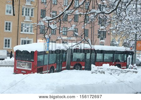 STOCKHOLM SWEDEN - NOV 10 2016: Snow chaos in the traffic in central Stockholm. Snow chaos in the traffic. A broken bus is abandoned. November 10 2016 in Stockholm Sweden