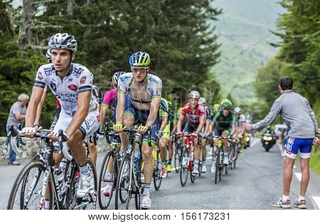 Col du Tourmalet France - July 24 2014: The peloton climbing the road to Col de Tourmalet in the stage 18 of Le Tour de France 2014.