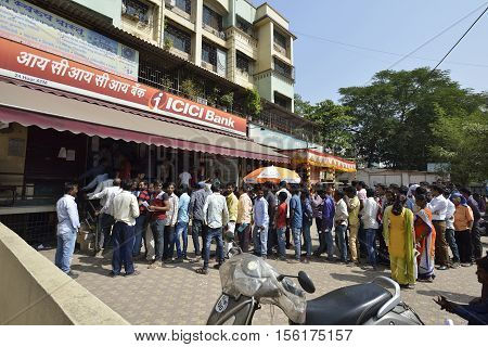 Bombay, India - November 12, 2016: People standing in long queue to withdraw money from banks after demonetization of  Rs.500 and Rs.1000 Indian currency notes